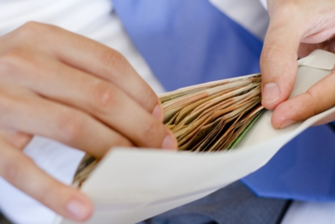 Man opening an envelope of money