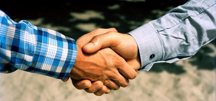 Two persons shaking hands